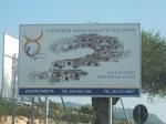 """Golfo Aranci, Spiaggia Bianca, cartello vendita """"appartamenti sulmare"""""""