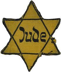 stella gialla di riconoscimento che gli ebrei dovevano obbligatoriamente portare sugli indumenti nei territori occupati dai tedeschi (1939-1945)