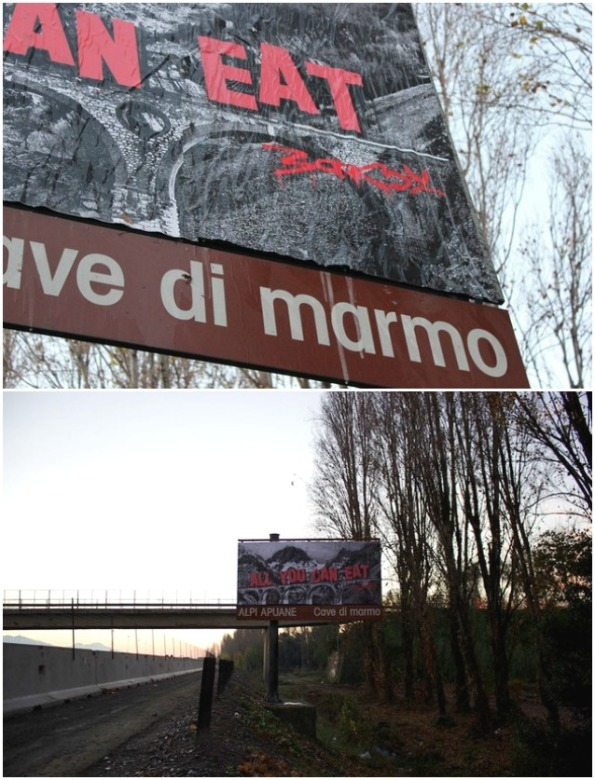 Autostrada A 11, presso Carrara, cartellone di Bansky